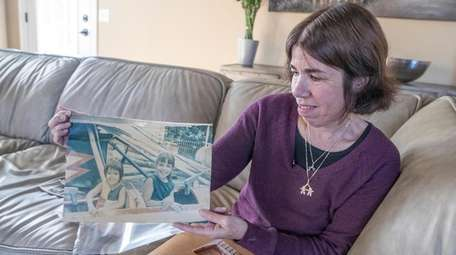 Irene Wilkowitz shows a photograph of her and