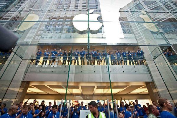 Apple Inc. employees cheer as the doors open