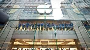 Apple Inc. employees cheer as the doors open