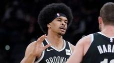Brooklyn Nets' Jarrett Allen, left, celebrates a basket