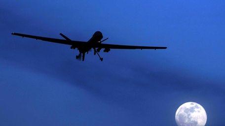 An unmanned U.S. Predator drone flies over Kandahar