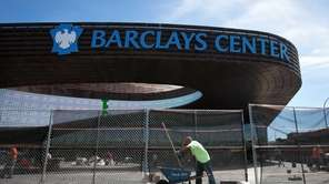 Construction workers outside Barclays Center in Brooklyn. (September