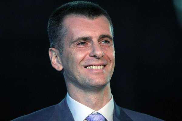 Brooklyn Nets owner Mikhail Prokhorov smiles as he