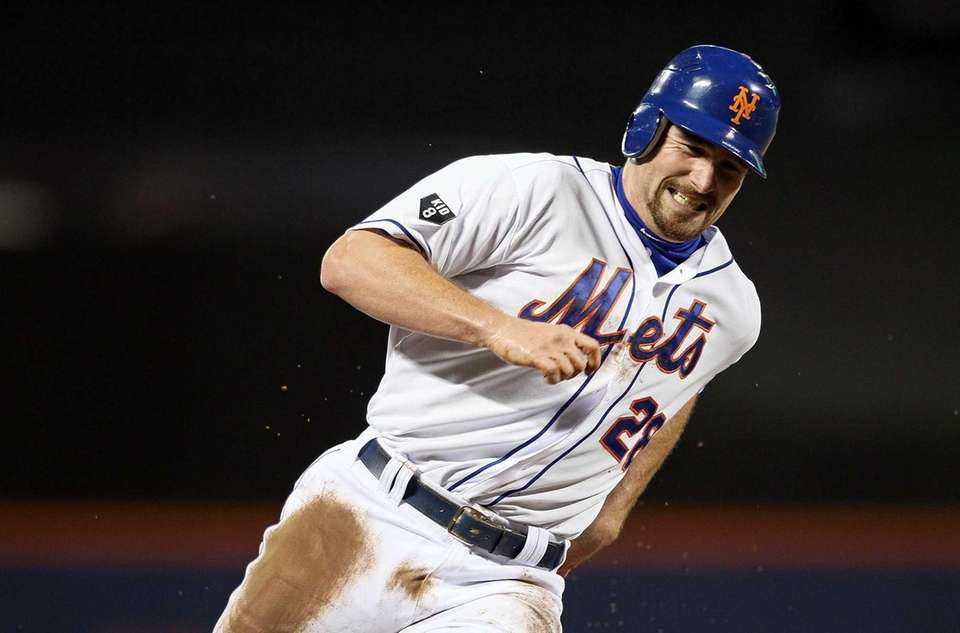 Daniel Murphy rounds third base during the first