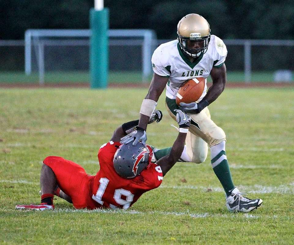 Longwood running back Isiah White, gets by Connetquot