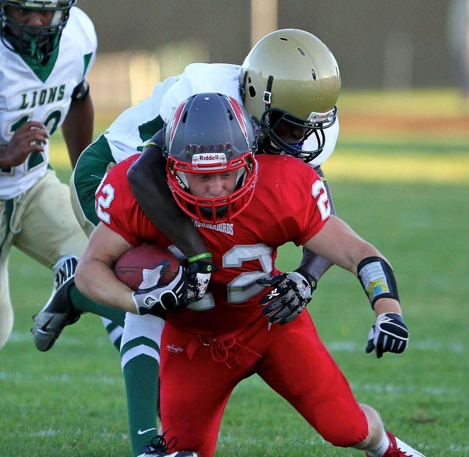 Connetquot running back Ryan Harvey tries to shake