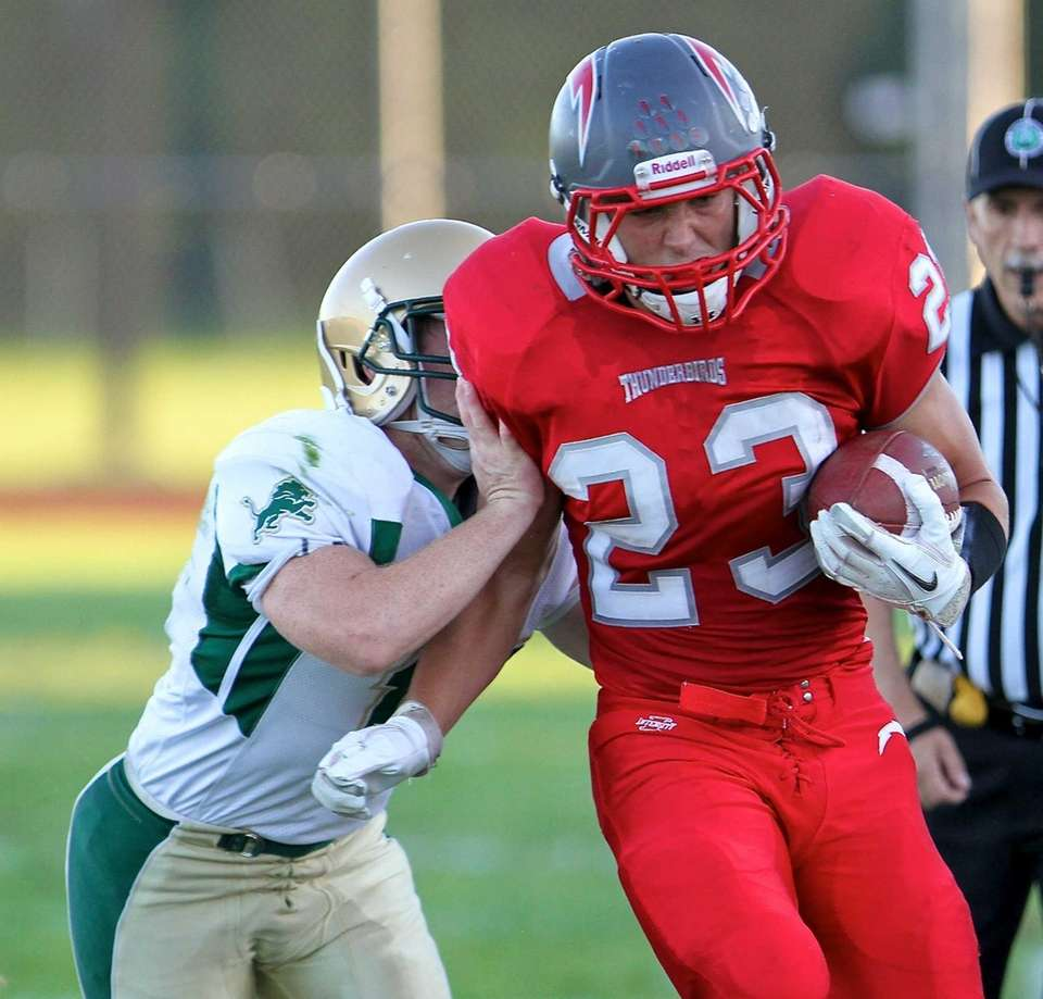 Connetquot running back Ryan Renfro, goes up the