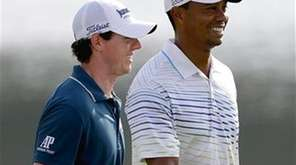 Tiger Woods and Rory McIlroy walk up the