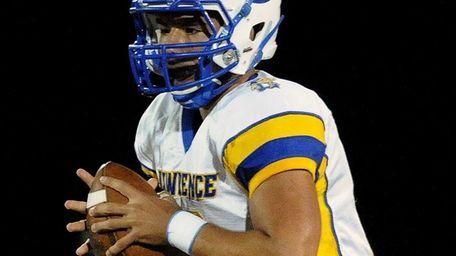 Lawrence quarterback Joe Capobianco looks for an open