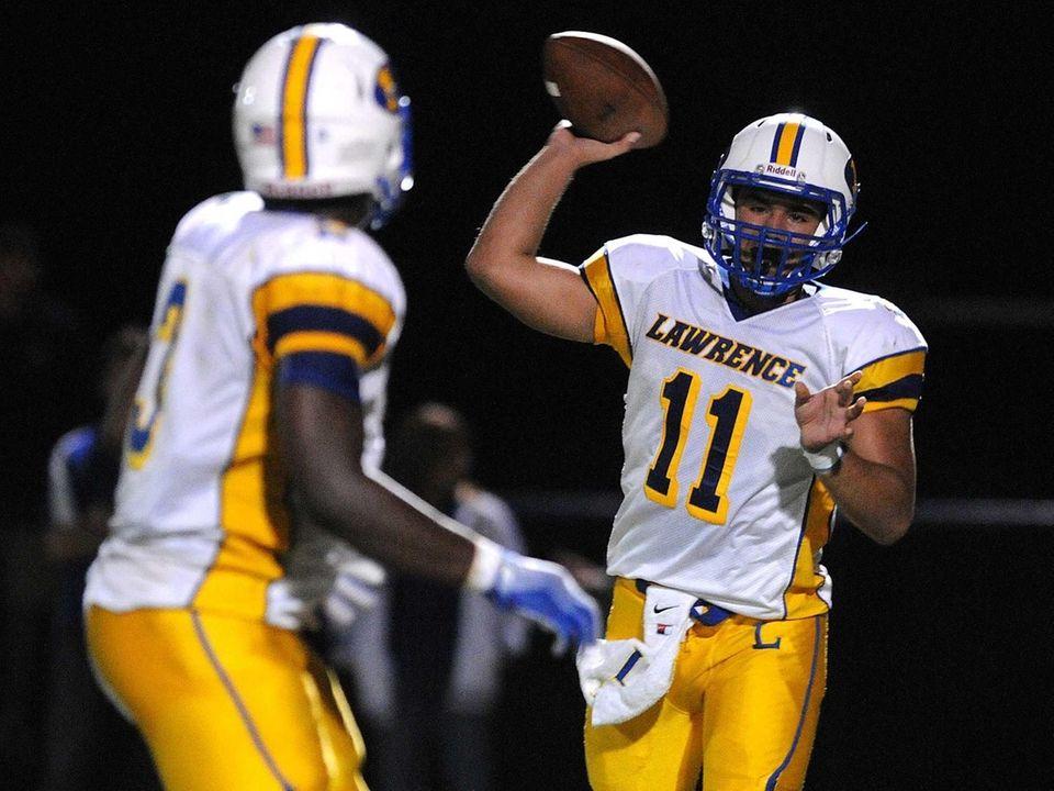 Lawrence quarterback Joe Capobianco, right, throws a pass