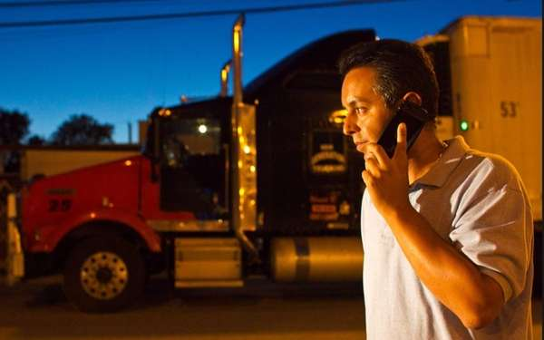 Manuel Velasco, 37, talks on the phone near