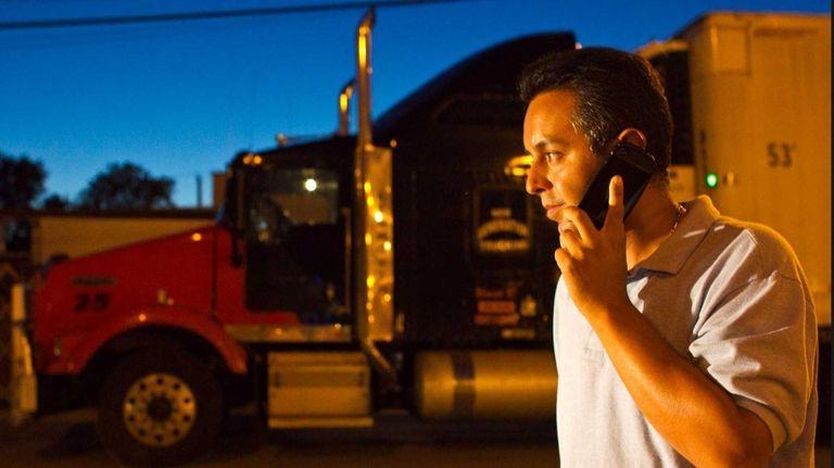 Manuel Velasco, 37, talks on the phone near