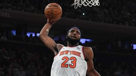 Knicks center Mitchell Robinson dunks against the Atlanta