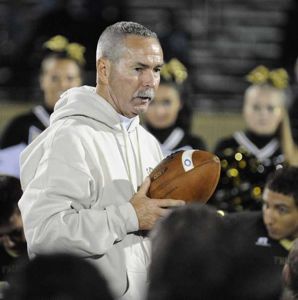 St. Anthony's head football coach Rich Reichert holds