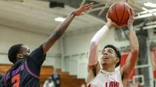 Long Island Lutheran's Andre Curbelo #11 goes up