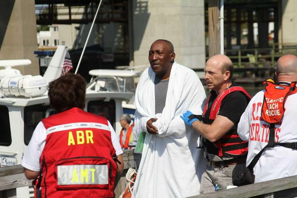 One of six people rescued from a capsized