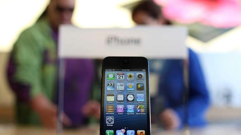 A new iPhone 5 is displayed at an