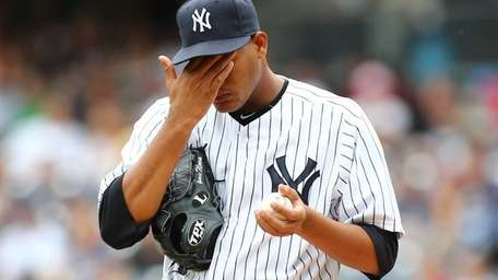 Ivan Nova stands on the mound in the
