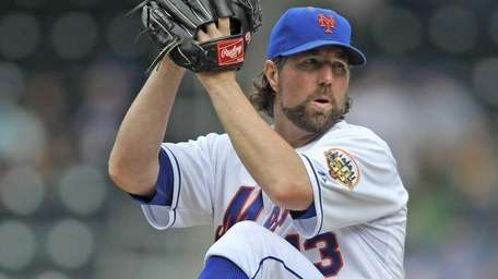 R.A. Dickey winds up to pitch during a
