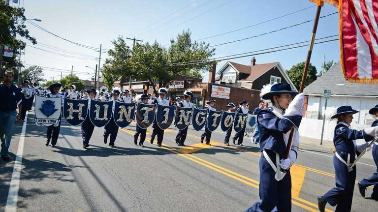 The Huntington Blue Devil Marching Band marches down