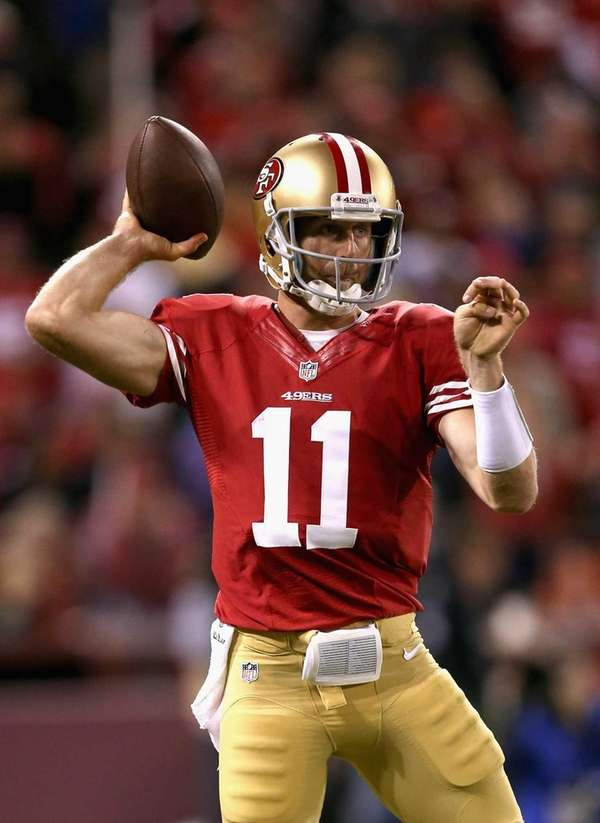 San Francisco 49ers quarterback Alex Smith passes the
