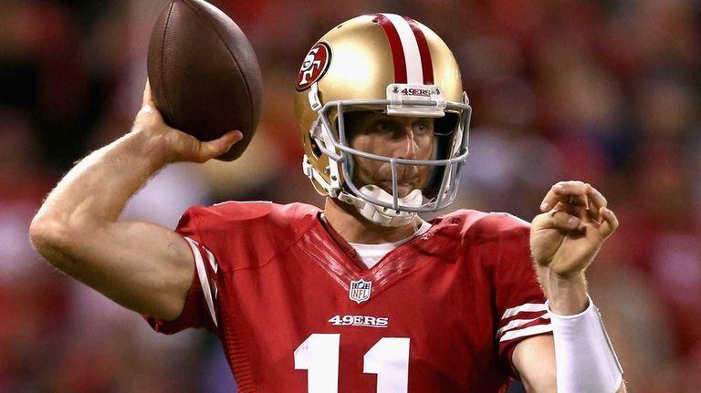 San Francisco 49ers quarterback Alex Smith passes the