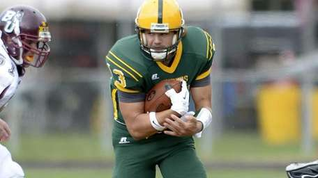 Post quarterback Steven Laurino carries the ball for