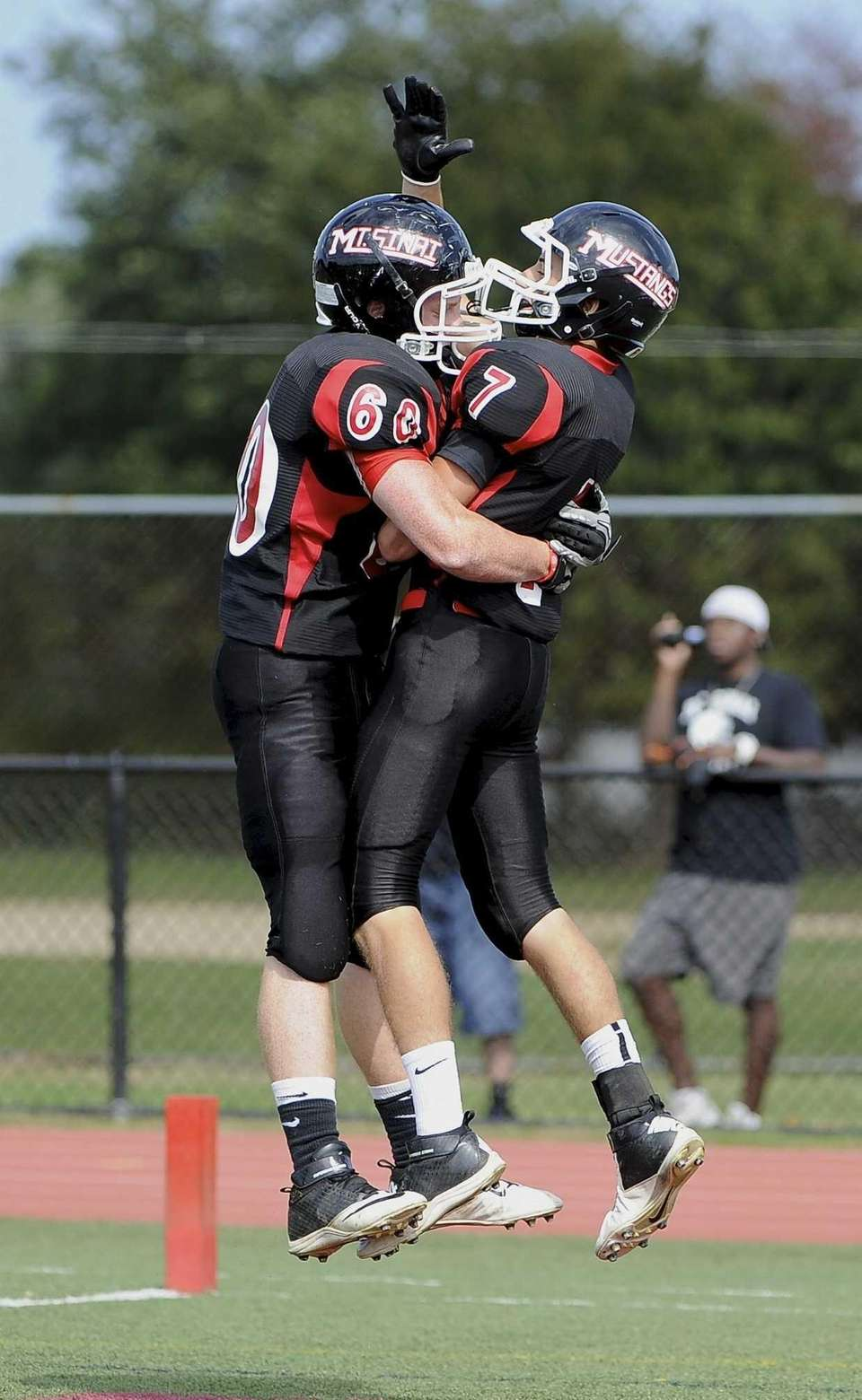 Mt. Sinai's Alex Pintabona, right, celebrates his touchdown