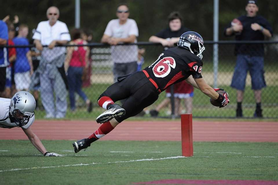 Mt. Sinai's Chris Farrell dives to score in
