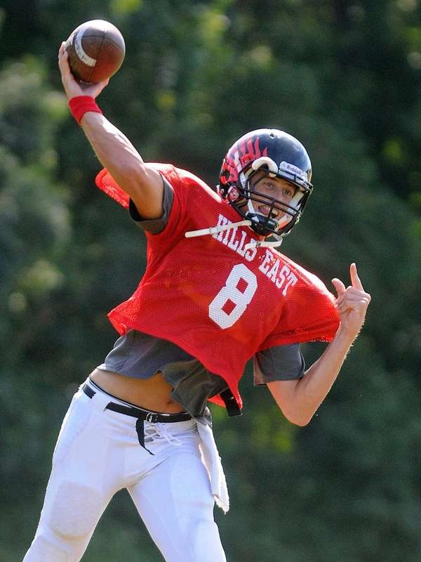 Half Hollow Hills East quarterback R.J. Nitti throws