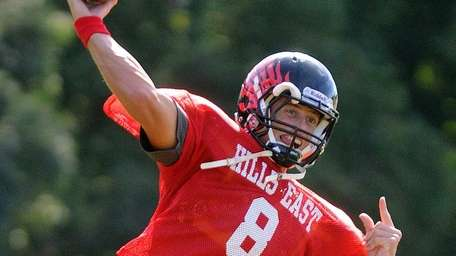 Half Hollow Hills East quarterback R.J. Nitti throws