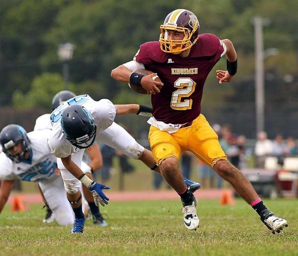 Kings Park quarterback Joe Guercio moves around Rocky
