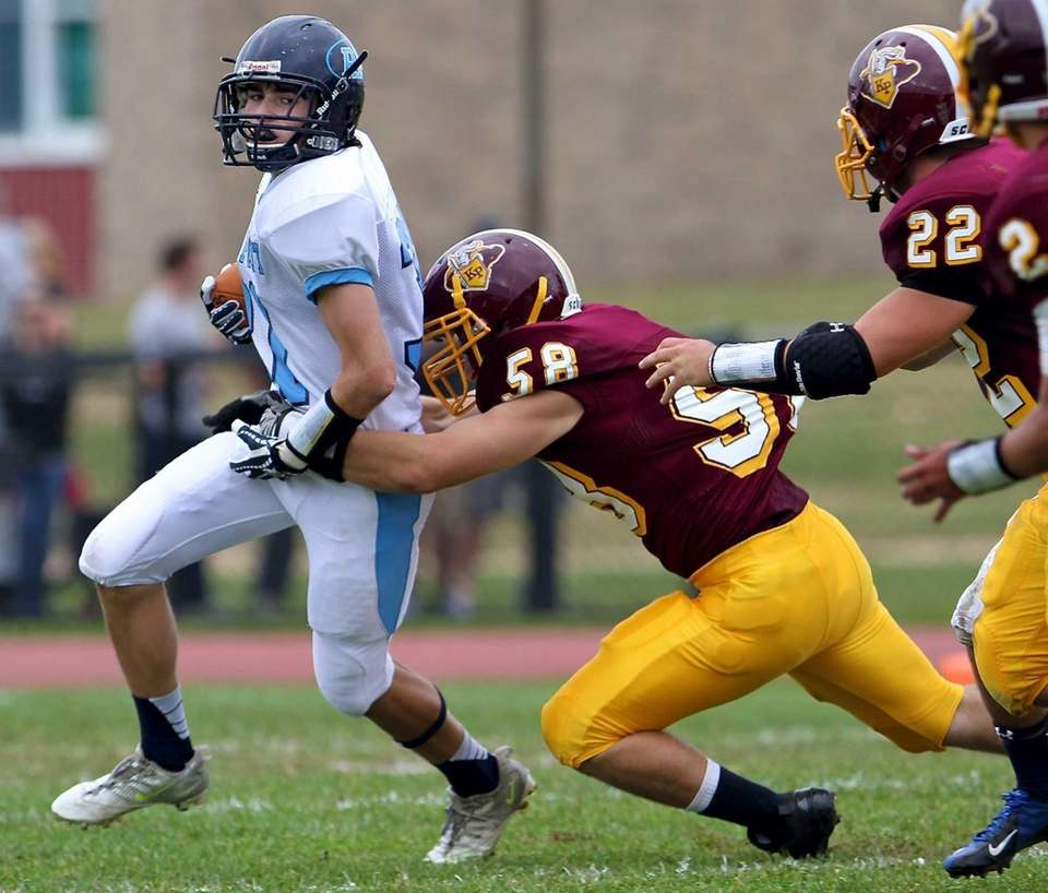 Rocky Point running back Sean Orlando goes outside,