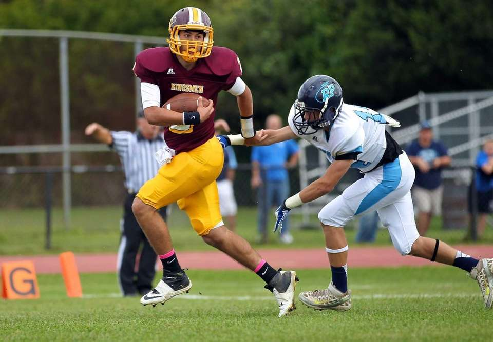 Kings Park quarterback Joe Guercio scrambles into the