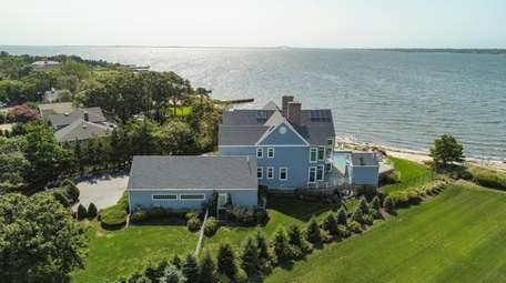 This large bayfront Colonial home in Islip is