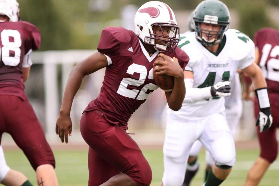 Bay Shore's Simcon Eato runs the ball during