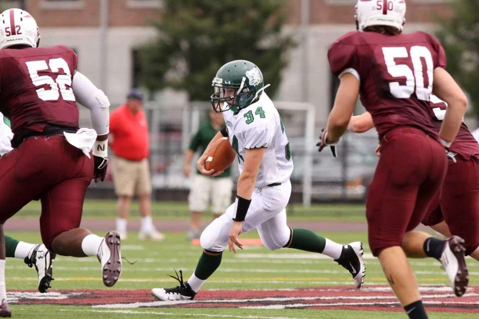 Lindenhurst's Kevin Harvey runs the ball against Bay