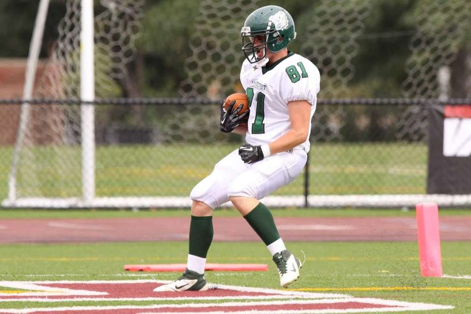 Lindenhurst's Mike Carson scores a touchdown against Bay