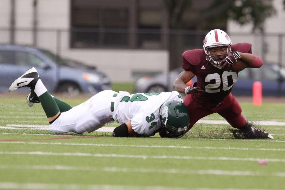 Bay Shore's Matthias Eato, right, is tackled by