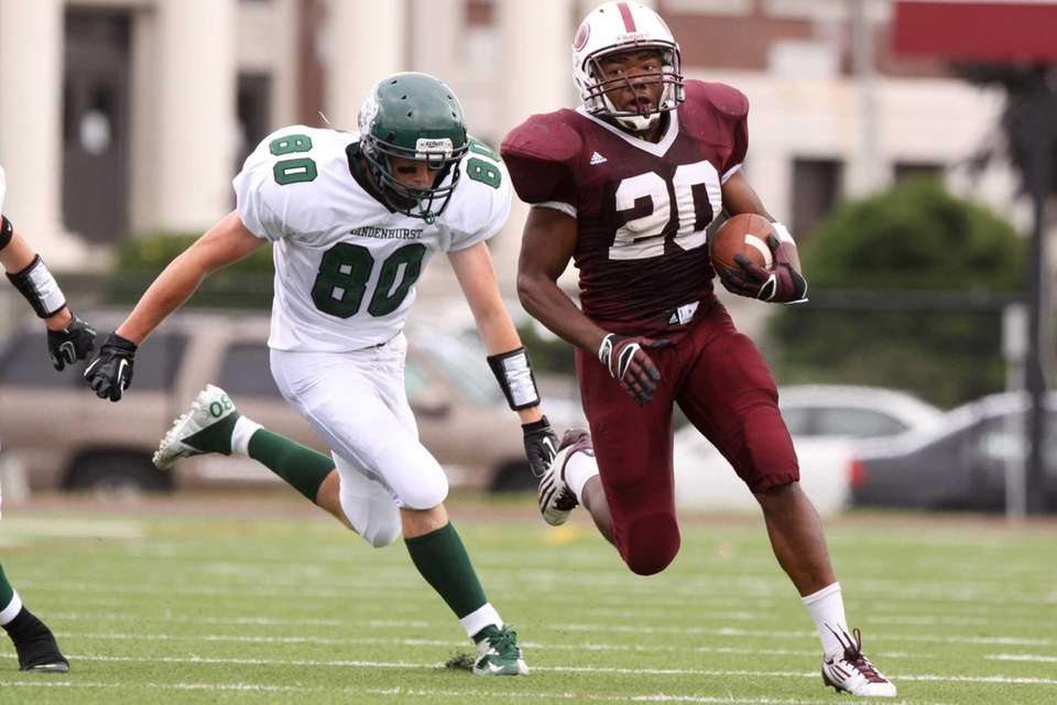 Bay Shore's Matthias Eato, right, runs past Lindenhurst's