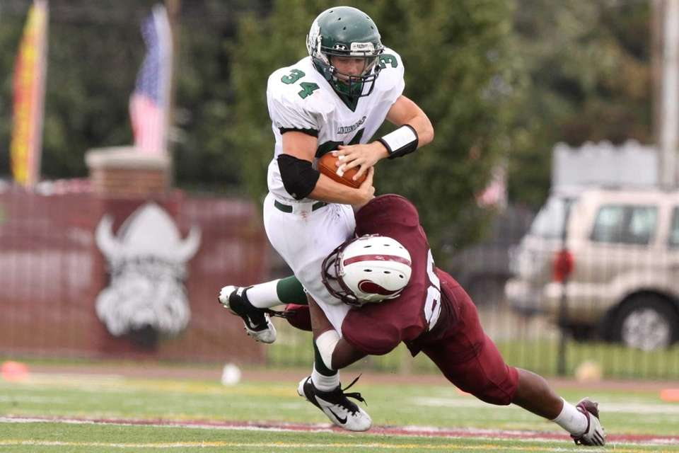 Lindenhurst's Kevin Harvey, left, is tackled by Bay