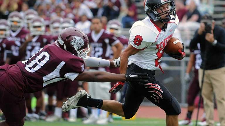 Newfield's Joe Latterra scores his second touchdown of