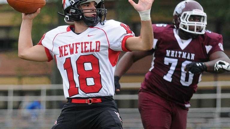 Newfield quarterback Brandon Riggi throws a pass during