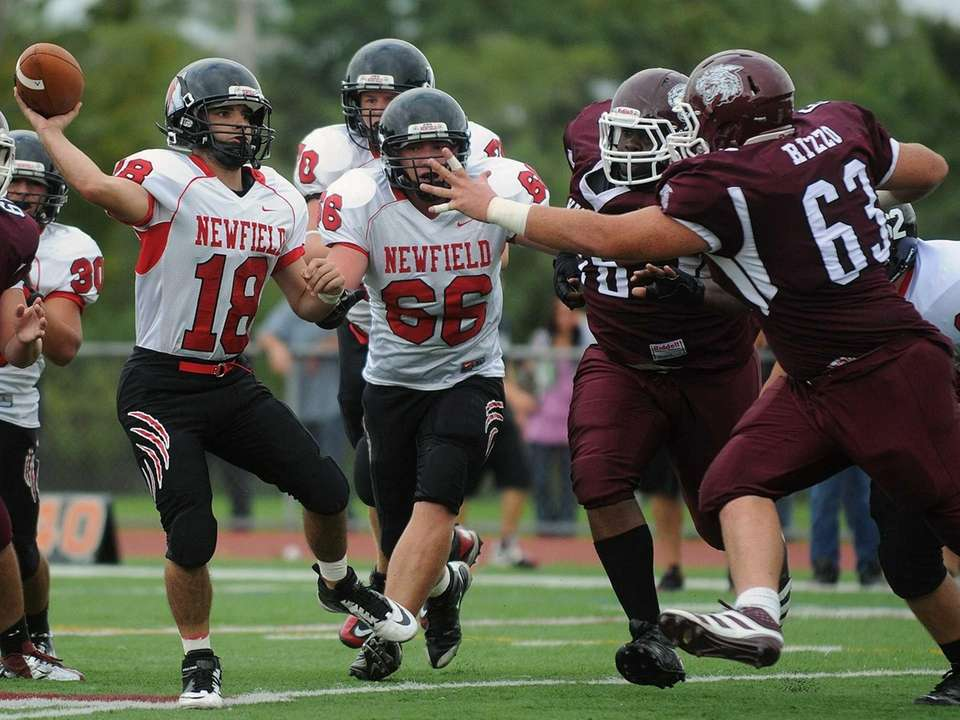 Newfield quarterback Brandon Riggi throws a pass during