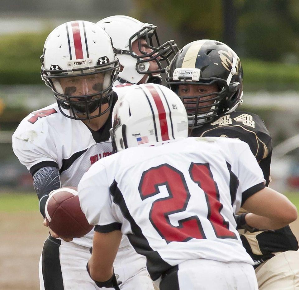 Island Trees's quarterback Ryan Carroll hands the ball