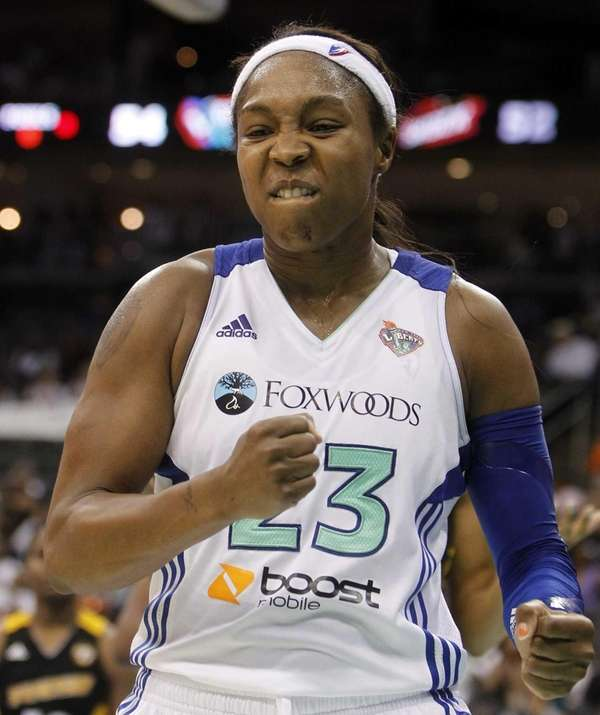 Cappie Pondexter celebrates after scoring a basket and