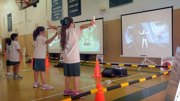 Children play active video games at St. Patrick's