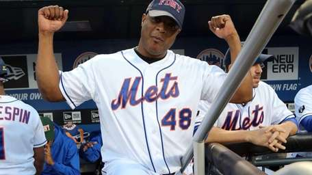 Frank Francisco gets loose before the game against