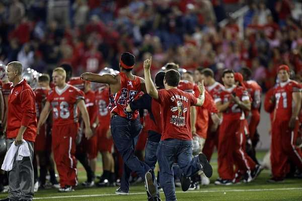 Stony Brook fans mob the field after their
