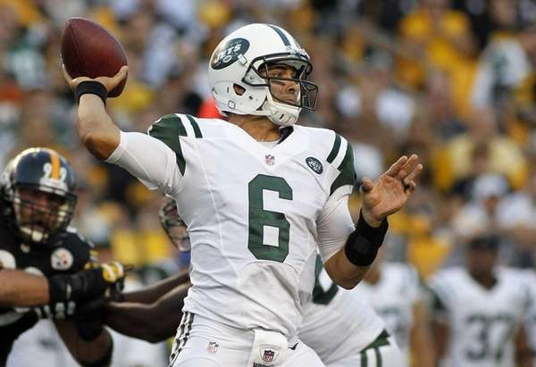 Mark Sanchez drops back to pass during a